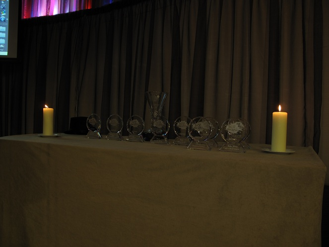 A table covered in cloth with candles on each end.  It's like an alter.