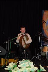 Darragh playing the Bodhran on stage.