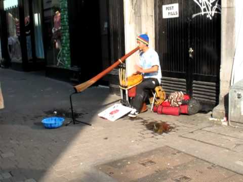 Busker in Galway playing the didgeridoo and the bongos at the same time.