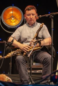Darragh Ó Héiligh playing the uilleann pipes on the main gig rig during the Fleadh Cheoil in Drogheda 2018