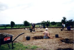 Image 8 - Students excavating at Dunragit timber circle, 1999. Image copyright Anne Teather.