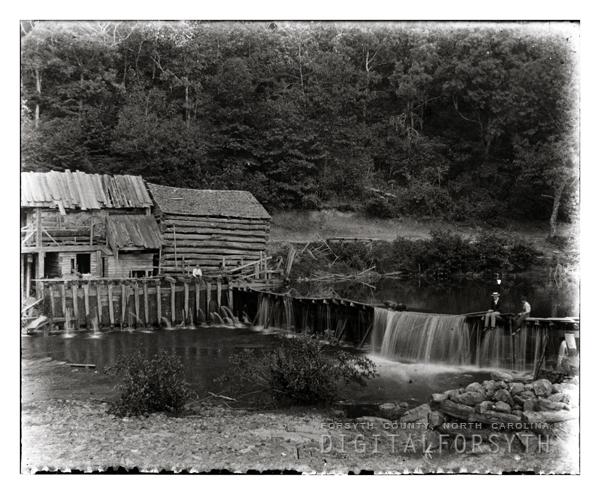 Men Fishing at a Dam