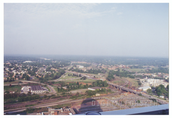 Aerial photo looking east toward Interstate 40 and Highway 52 interchange, 1996.