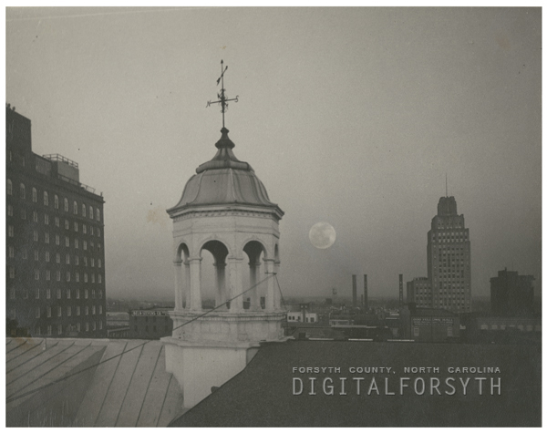 Downtown skyline showing, from left, the Robert E. Lee Hotel, First Baptist Church, and the Reynolds Building, 1959.