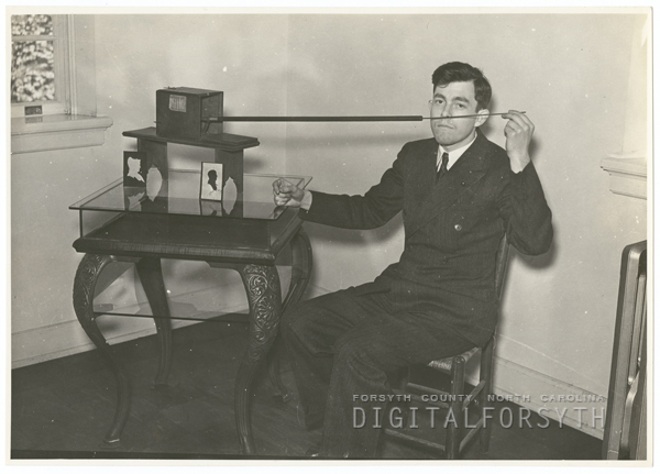 Frank Jones with the silhoutte machine in the John Vogler house in Salem, 1938.
