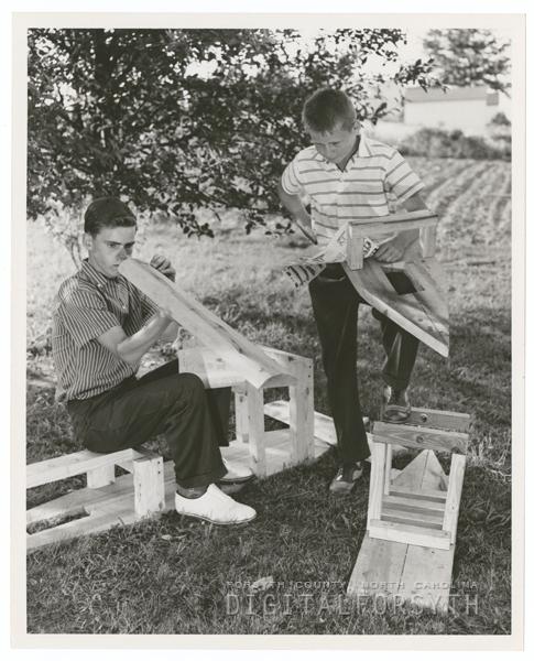 Preparing for the Soap Box Derby, 1958.