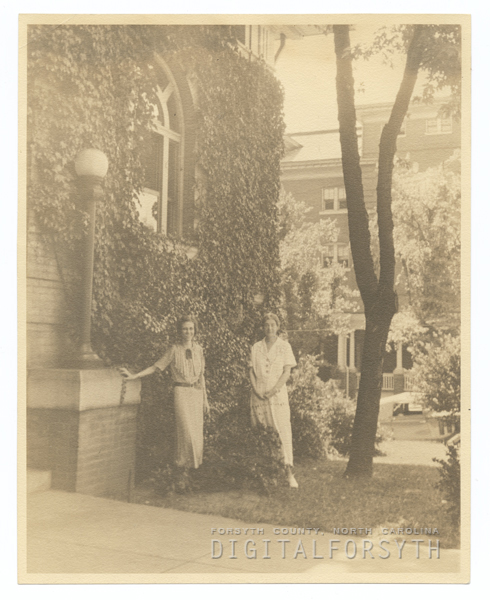 Carnegie Librarians, Nell Nettles and Janet C. Berkeley, in front of the Carnegie Library.