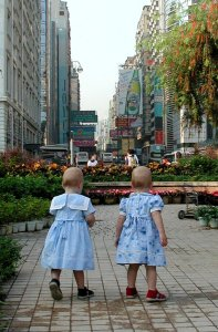 "The twins ""discovering"" the wonders of Hong Kong at just over a year old."