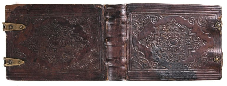 open leather cover of an English 16th century table book