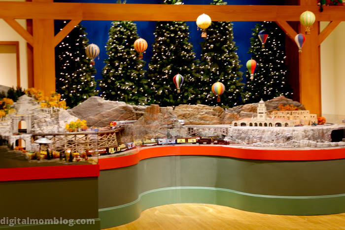 """The hot air balloons dance up and down and a train themed like """"The Christmas Story"""" runs through the train exhibit"""