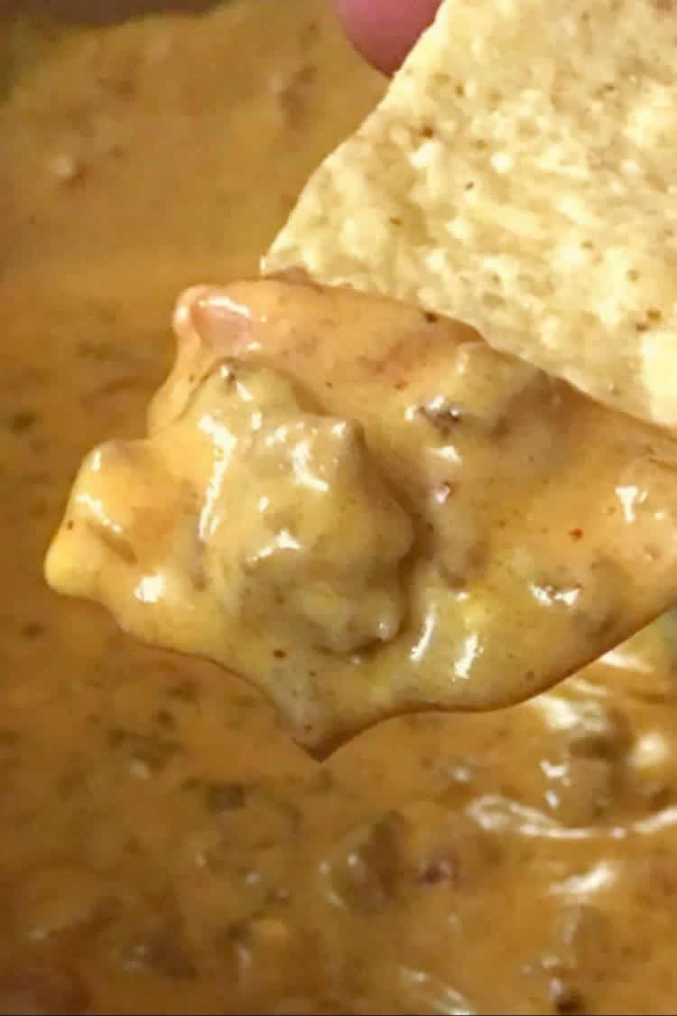 chip dipped into chili con queso made in the instant pot