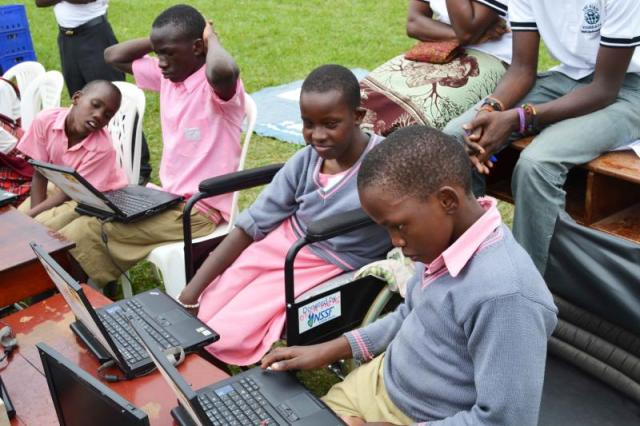 Students from schools of special needs being trained to use computers