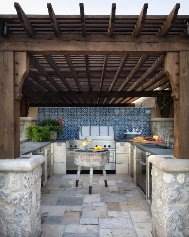 Even an outdoor kitchen might benefit from a small island.