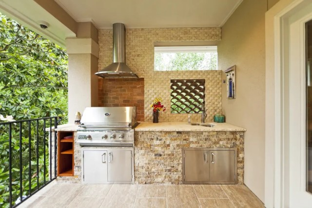 If you have a spacious balcony then an outdoor kitchen might be a great addition to it.