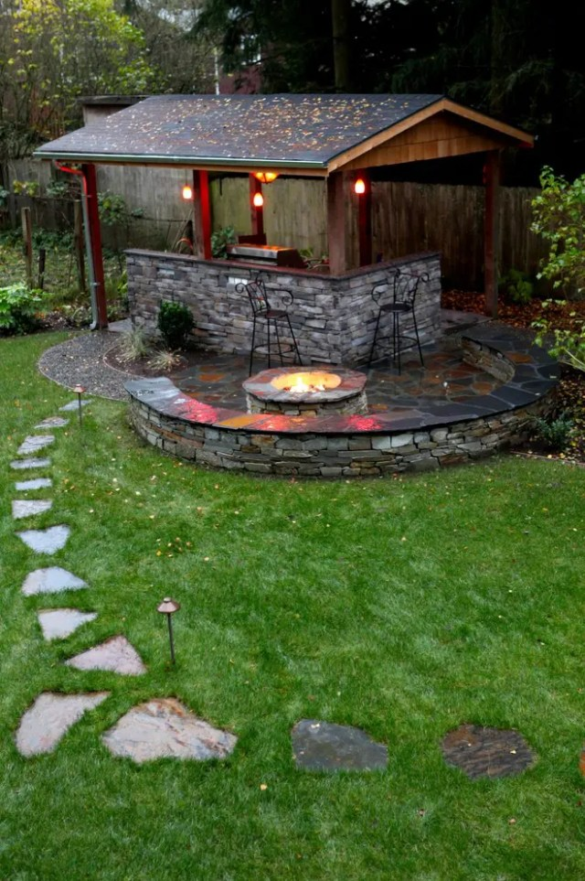 A fire bowl right next to the outdoor cooking zone would make an entertaining there more cozy.