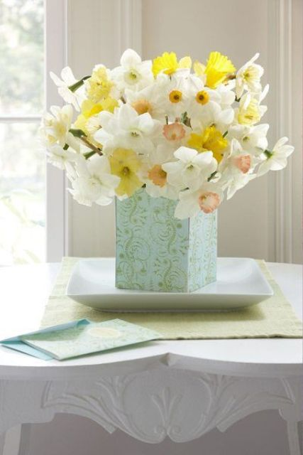 a blue vase with yellow and white daffodils is a classic spring flower arrangement that you may compose