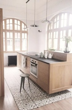 30 Practical And Cool Looking Kitchen Flooring Ideas   DigsDigs mosaic floor tiles under the kitchen island and wooden floors around