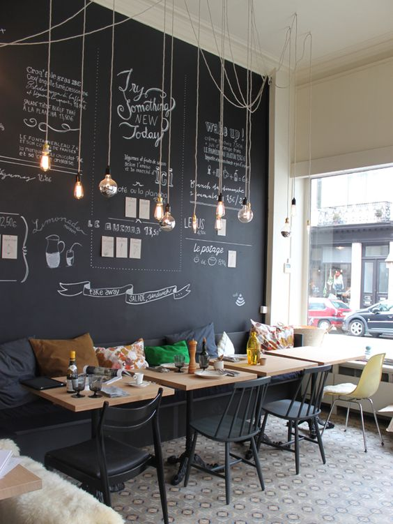 35 Cool Coffee Shop Interior Decor Ideas   DigsDigs modern and cheerful coffee shop decor with a chalkboard wall and hanging  bulbs