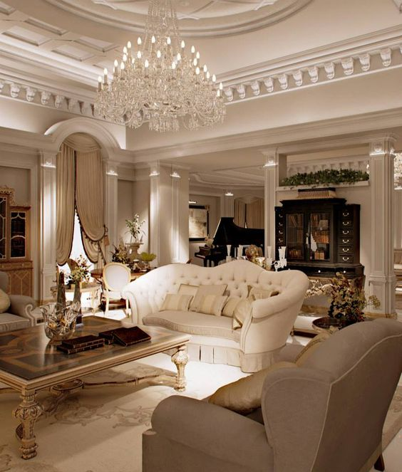 A Refined Living Room With An Oversized Crystal Chandelier Lot Of Bulbs