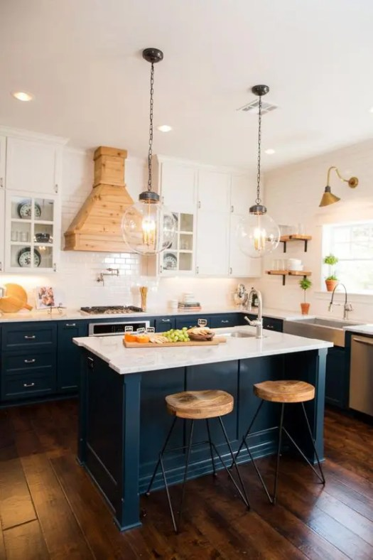 Dark Blue Kitchen Cabinets With Marble Countertops And Suspended White