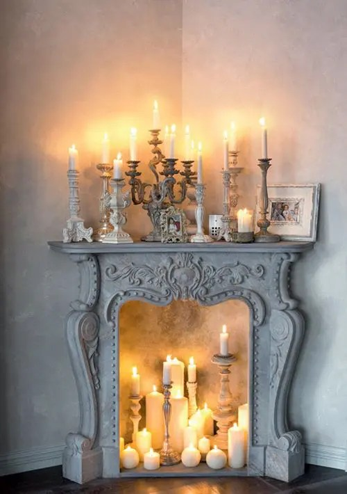 We may earn commission on some of the items you choose to buy. 30 Adorable Fireplace Candle Displays For Any Interior