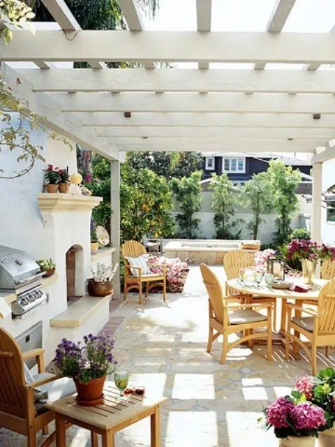Even a pergola could provide enough protection for an outdoor cooking and dining.