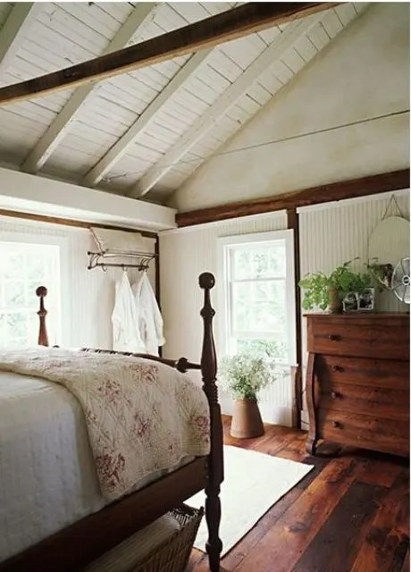 Burlap lamps adorned with white rosettes placed on elegant pedestal tables, and a textured bedspread with burlap accent pillows complete the look. 37 Farmhouse Bedroom Design Ideas that Inspire - DigsDigs