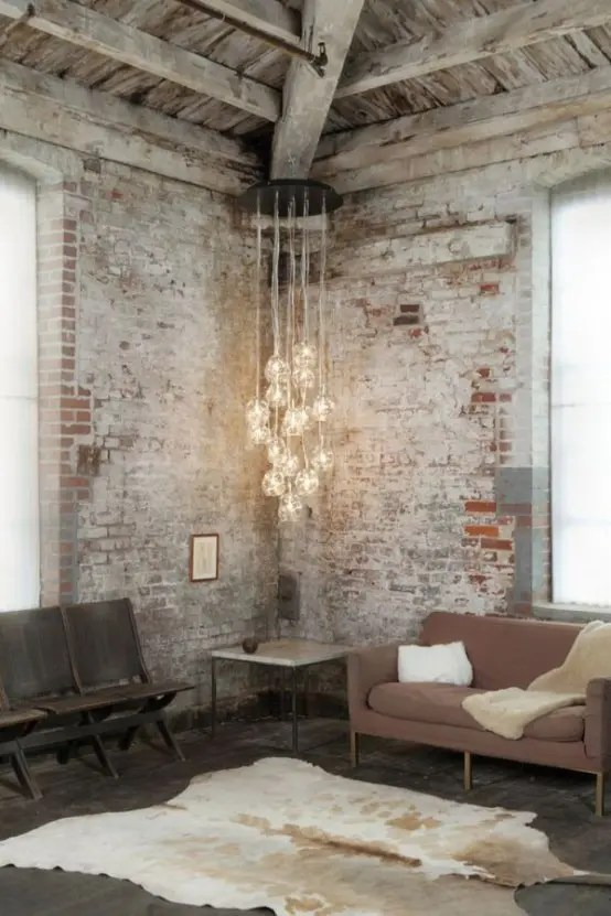 An easy way to make the exposed brick wall look chic in the living room is to update it with chic furniture and other accessories. 37 Impressive Whitewashed Brick Walls Designs - DigsDigs