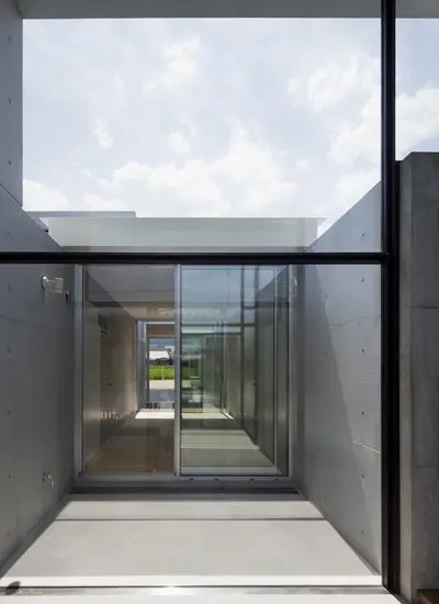 Minimalist House Design That Consist Of Small Rectangular