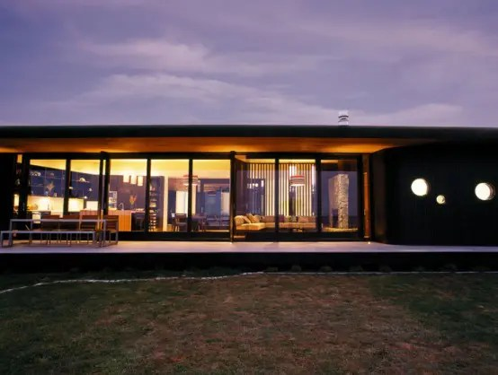 Single Story Two Wings House With Dark Cedar Cladding On