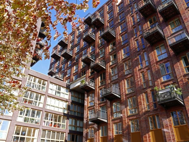 A brown high rise residential building - real estate investor