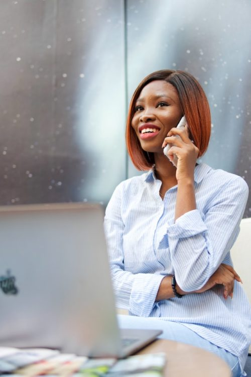 A customer service lady on phone serving a  client - customer care number on use