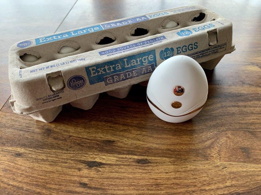 CalExotics Empowered Smart Pleasure Goddess Vibrator sitting next to a carton of eggs