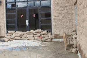 Sandbags made and placed by Navajo Technical University staff and students reduced flood damage to some campus building in Crownpoint, NM, on Sept. 13, 2013. Courtesy photo