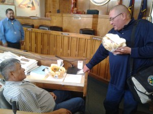 Navajo Council Resources & Development Committee member George Apachito and Agriculture Department Director Leo Watchman continue talking about proposed Grazing Act at Council chamber in Window Rock, Ariz. Photo by Marley Shebala