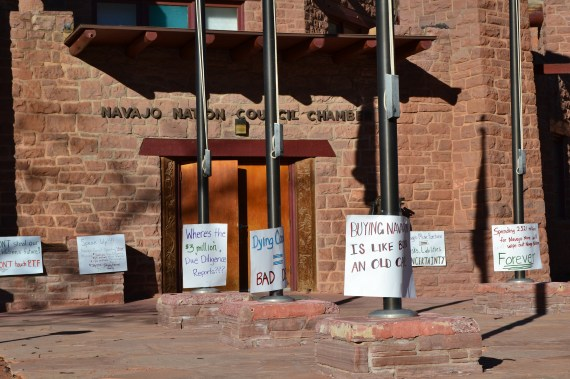 Protesters against Legislation 0367-13 posted signs in front of the Navajo Council chamber on Dec. 27, 2013. Photo by Marley Shebala
