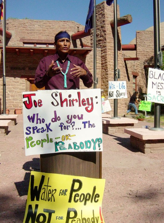 To' Nizhoni Ani co-coordinator Marshall Johnson was among numerous speakers and protesters at Navajo Nation Council chamber in Window Rock on July 18, 2005, to oppose proposed Navajo Nation water rights settlement involving Peabody's continued use of Navajo Aquifer for coal mining. Photo by Marley Shebala.