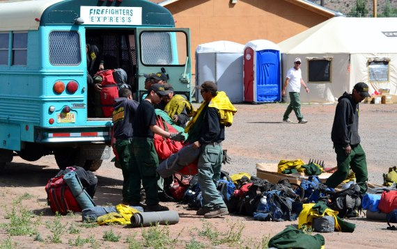 The Navajo Nation's own Type 2 wild land firefighters, Navajo Scouts, pack up their bus to return to the Asaayii Fire from the SW Incident Management Team 3 Command Center in Fort Defiance, Ariz., on June 23, 2014. Photo by Marley Shebala. (Please give proper photo credit when reusing photo.)
