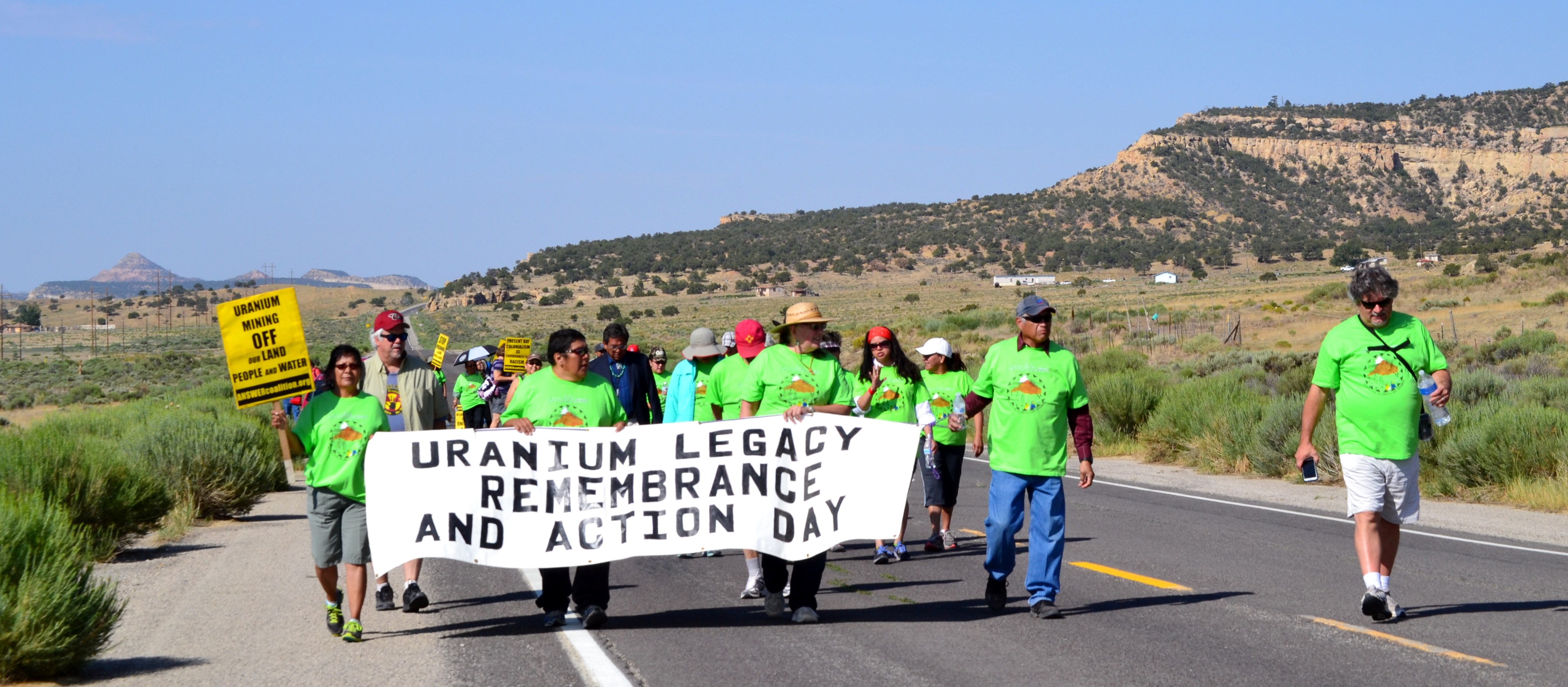 On July 19, 2014, people from across the Navajo Reservation and their supporters remembered the July 16, 1979, radioactive disaster with a walk to the United Nuclear Corporation uranium tailings flood site and memories of loved ones that died from cancer related to the former uranium mining in the area and the radioactive flood. Photo by Marley Shebala. (Please provide proper photo credit when reusing photo.)