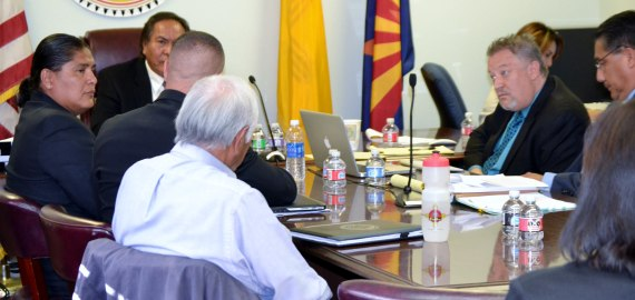 In the Navajo Nation Office of Hearings and Appeals in Window Rock, Ariz., on Oct. 9, 2014, then presidential candidate Chris Deschene, who is on left side of photo, is cross-examined by the attorneys, David Jordan and Justin Jones, who sit on the left side of photo, for plaintiffs Dale Tsosie and Hank Whitethorne. Hearing Officer Richie Nez sits to the left of Deschene. Photo by Marley Shebala. (If photo re-used, please give proper credit.)