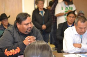 (L-R) Navajo Board of Election Supervisor Jonathan Tso, who represents the Shiprock, N.M., Agency, successfully motioned to delete legislation that would have postponed Nov. 4 general election for only presidency and vice presidency positions until all issues resolved during Oct. 13, 2014, board meeting in Window Rock, Ariz. Western Agency Supervisor Norman L. Begay voted for deletion. Disqualified presidential candidate Chris Deschene sits behind Begay. Photo by Marley Shebala (Please provide proper credit when reusing photo)