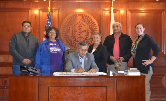 Navajo Nation President Ben Shelly signs Executive Order No. 14-2014  to ensure access to all  community services for people with disabilities across the Navajo Nation in the Office of the President and Vice President in Window Rock, Ariz., on Nov. 17, 2014.  (Courtesy photo and cut-line)