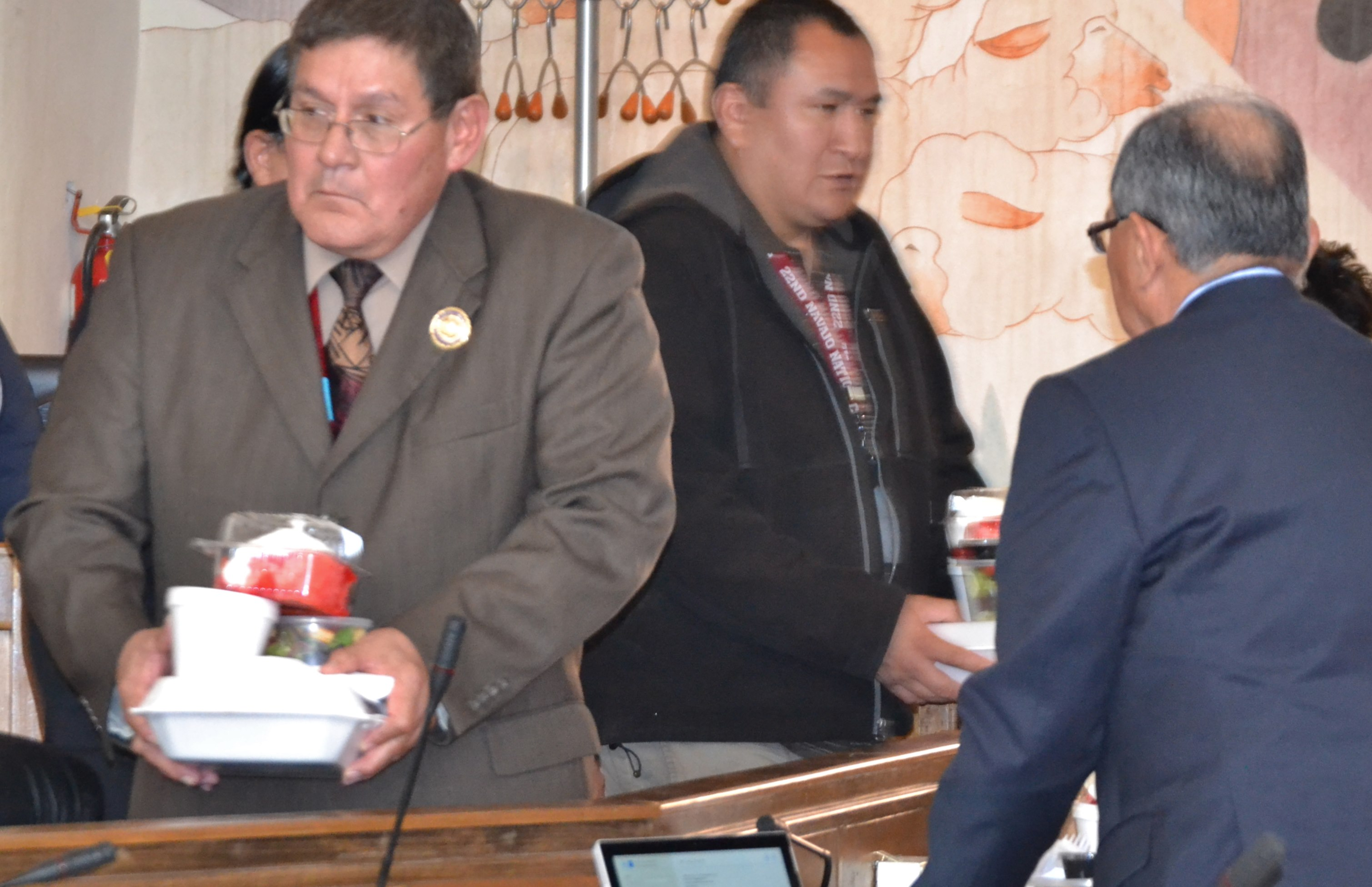 Navajo Council Speaker LoRenzo Bates shows his skills as a waiter during the Navajo Nation Council special session at the Council chambers in Window Rock, Ariz., on March 13, 2015. Photo by Marley Shebala. (Please provide proper credit when re-using photo.)
