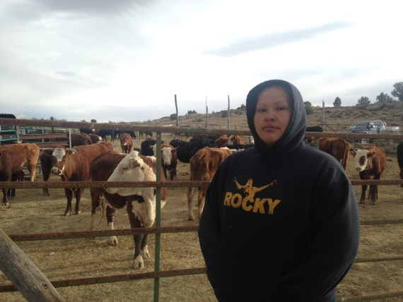 Walee Crittendon stands with her family's livestock after the initial theft by armed rangers. Courtesy photo.