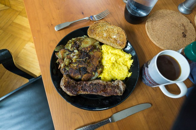 Breakfast with steak eggs and home fries