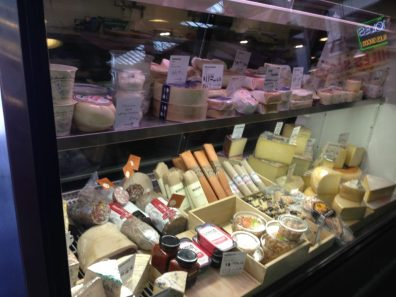 Cheese Vendor in Grand Central Market with assortment of specialty cheese