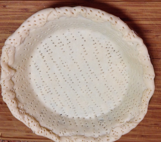 Pie Crust forked to death for Spicy Sausage and Egg Pie Recipe