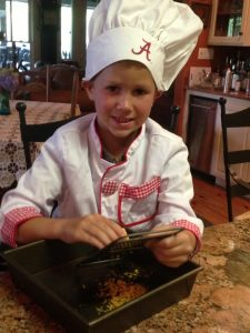 Wee Chef with Alabama Chef's Hat grating cheese
