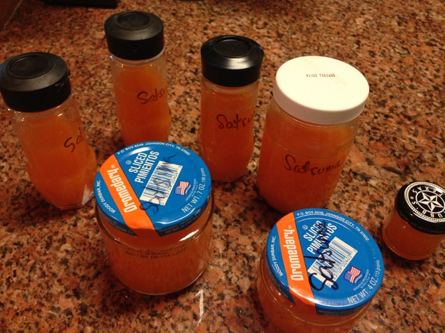Glass Jars with Satsuma Juice ready to be placed in freezer