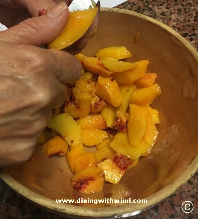 Peeling fresh peaches for Rustic Peach Tart www.diningwithmimi.com